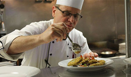 Chef prepares food in Branson, MO
