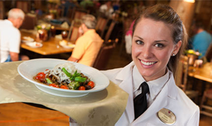 Student waitress works for tuition at The Keeter Center